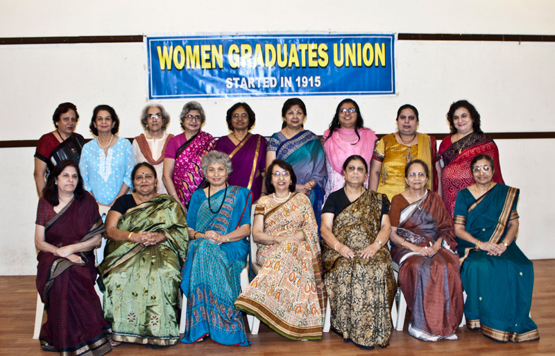 Photograph women executives in sari