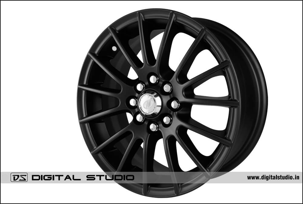 Photograph of black alloy wheel