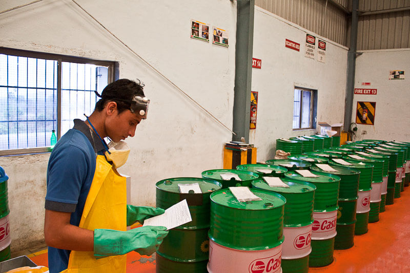 Worker in a warehouse with drums