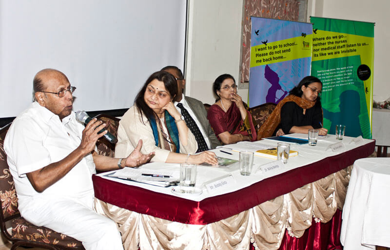 Panel members discussing during a corporate event