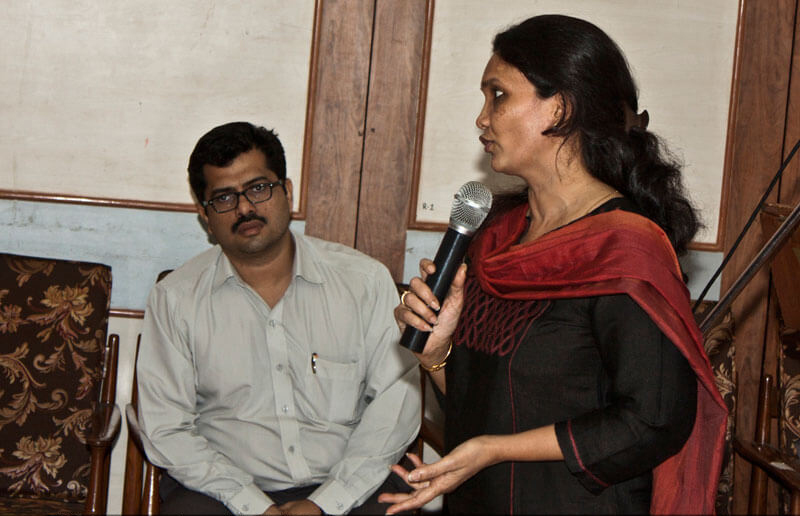 A corporate executive talking at an event