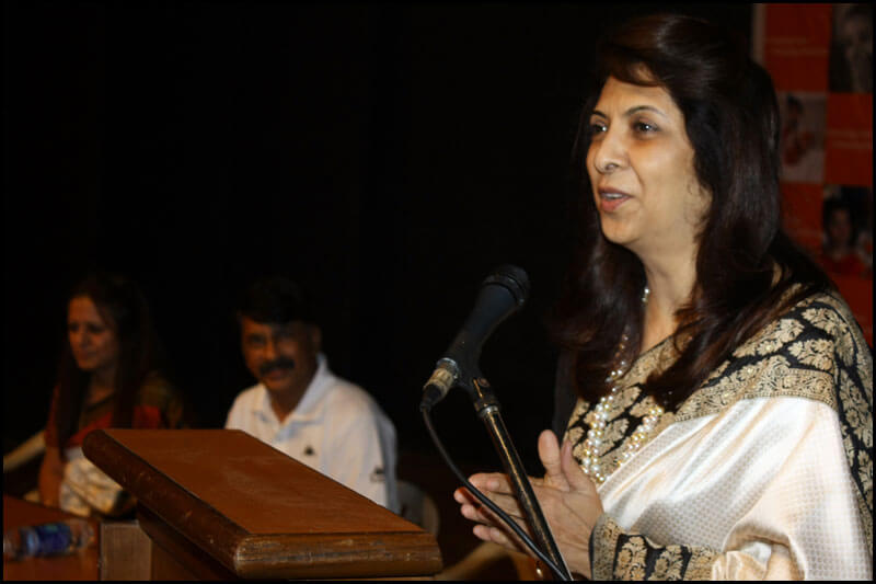 Dr. Indu Shahani delivering a speech at corporate event