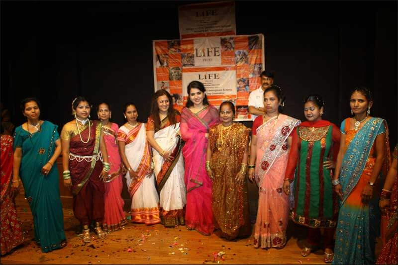 Dr. Indu Shahani with group of women at corporate event
