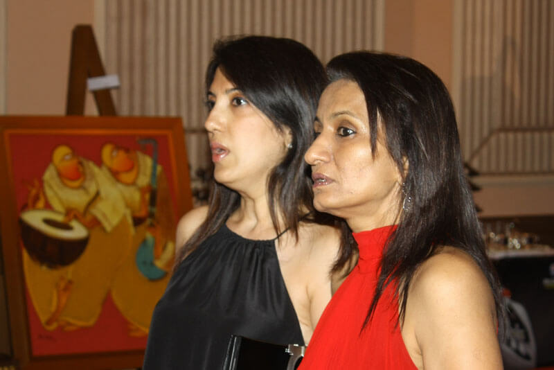 Two women executives at a corporate event