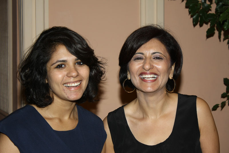 Two women smiling at an event