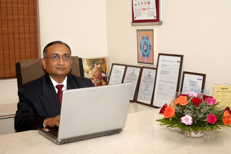Photograph of an executive on desk in Rajkot