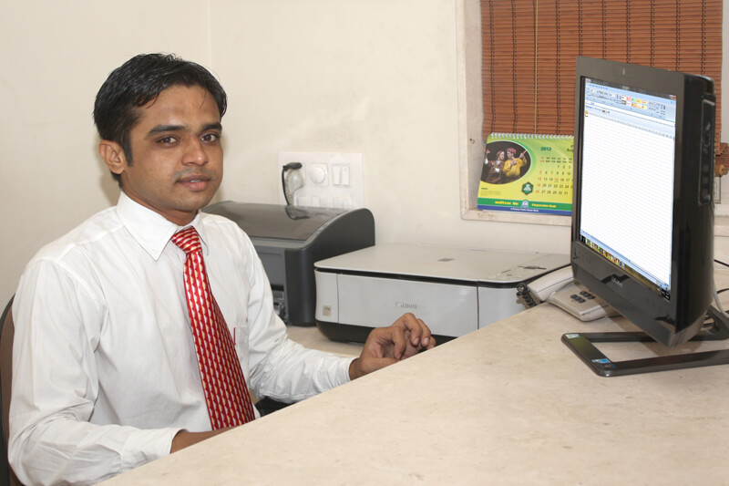 Photograph of an executive working on computer in Rajkot