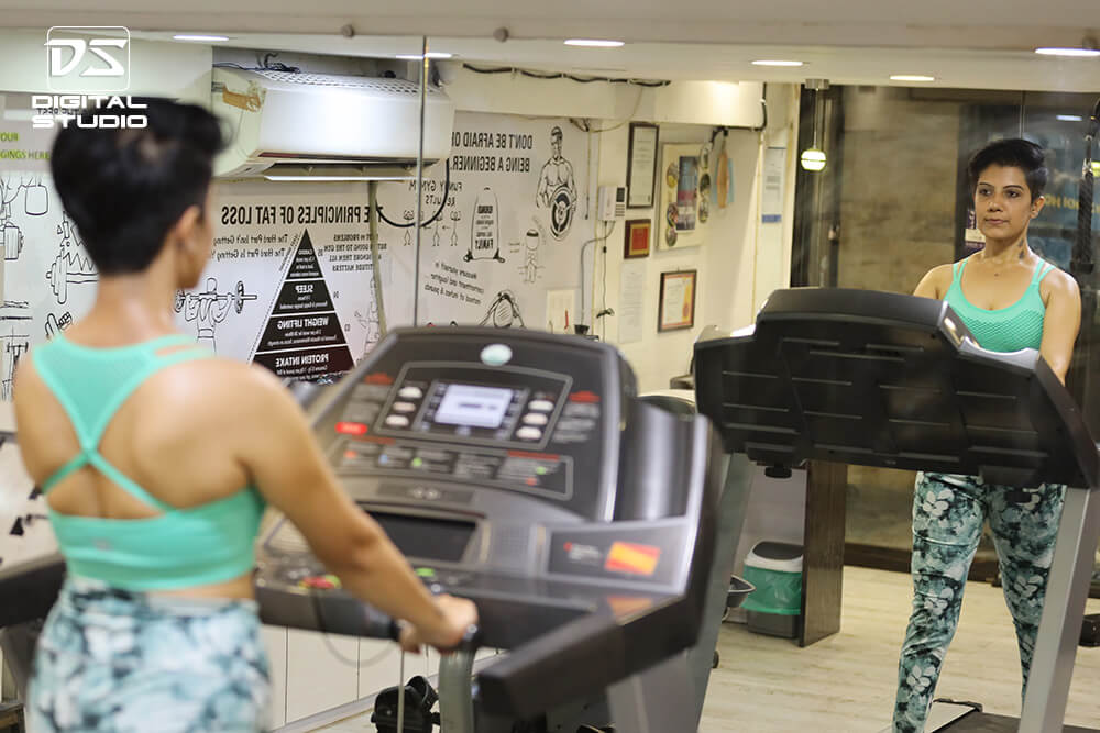 Young fitness model on doing cardio on treadmill