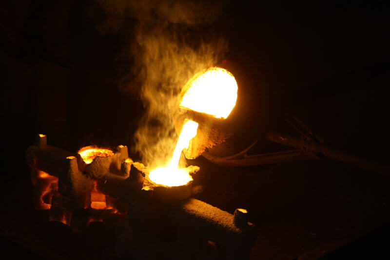 Molten metal being poured in a foundry