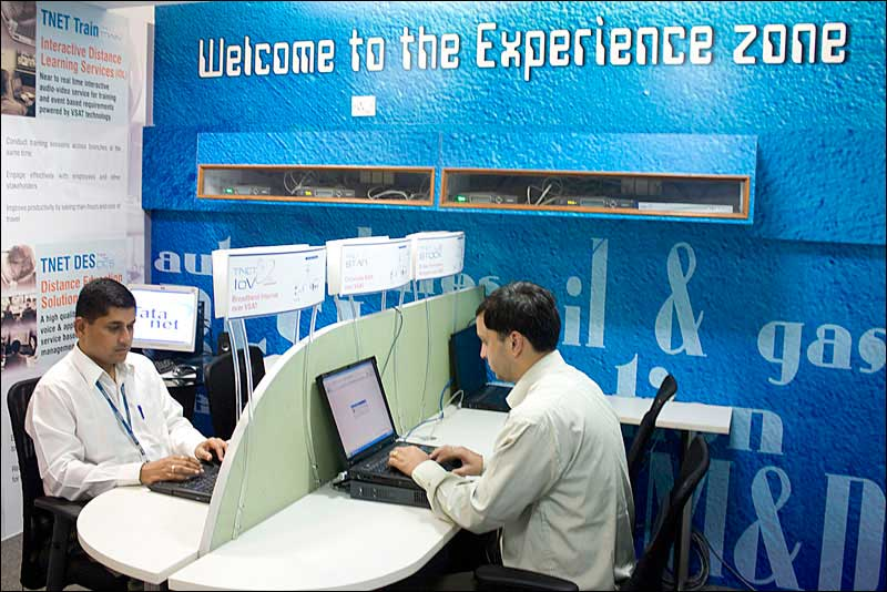 Photograph of two executives working on computers