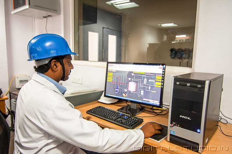 Worker in a Control room of a pharma plant