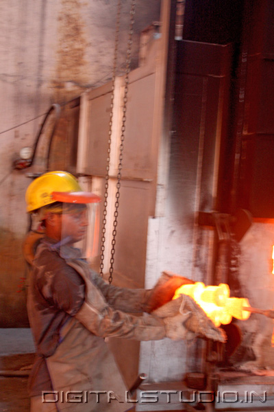Photograph of  Worker with molten iron