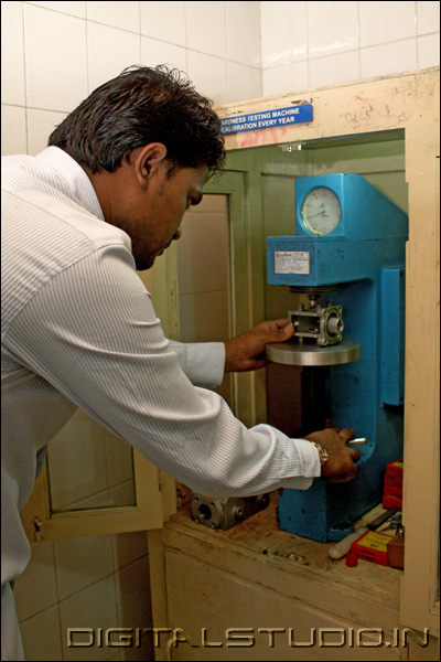 Worker in a factory testing equipment