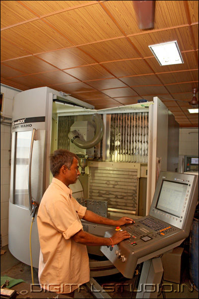 Worker on a CNC machine