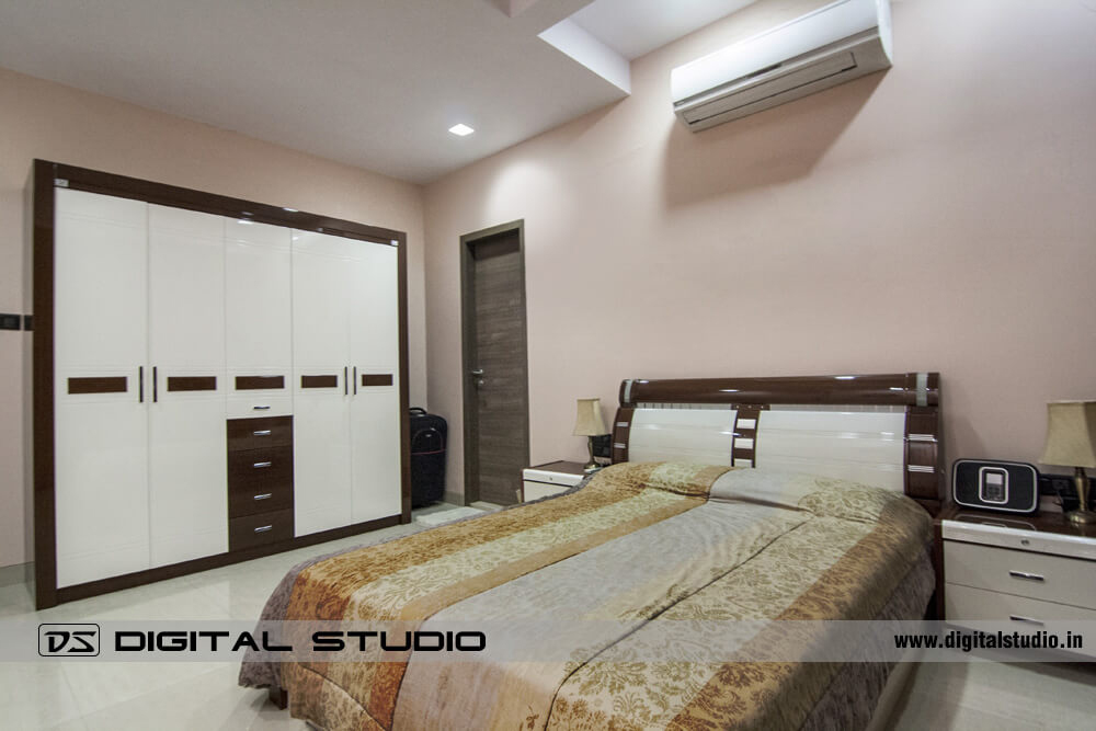 Master bedroom with double bed and wall unit