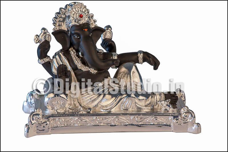 Photograph of  sitting black Ganehsa idol