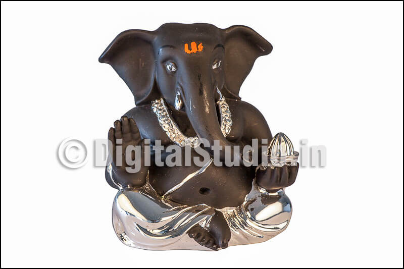 Silver and black Ganesha in sitting pose