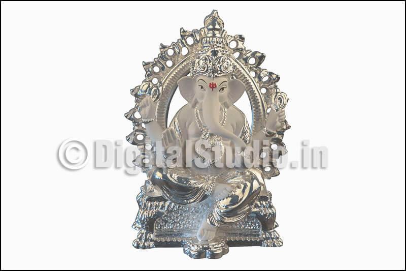 Photograph of  sitting silver Ganehsa idol