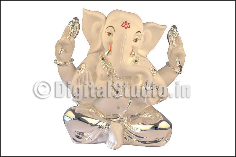 Clay and silver Ganesha idol