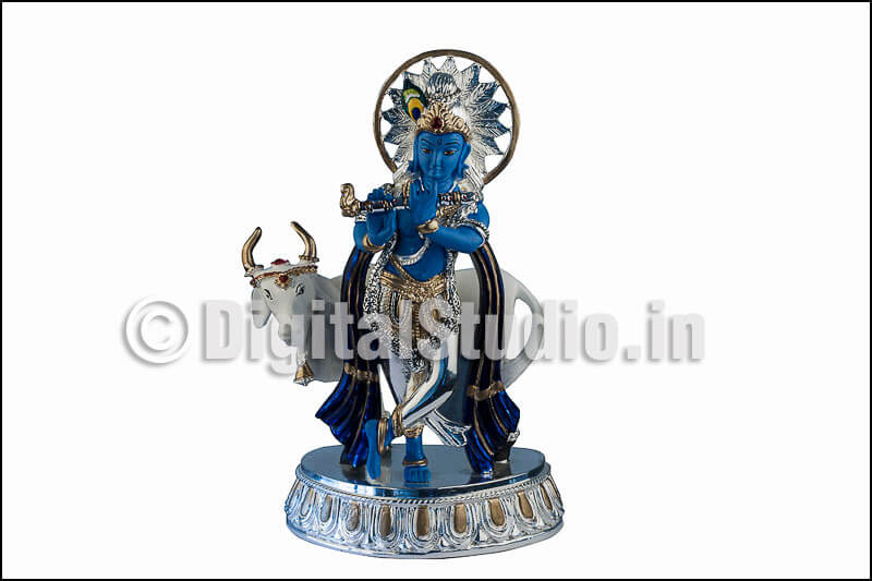 Kirshan idol with cow in standing pose