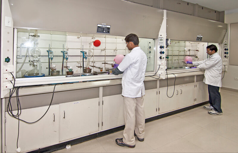 Wide angle photograph of lab with workers