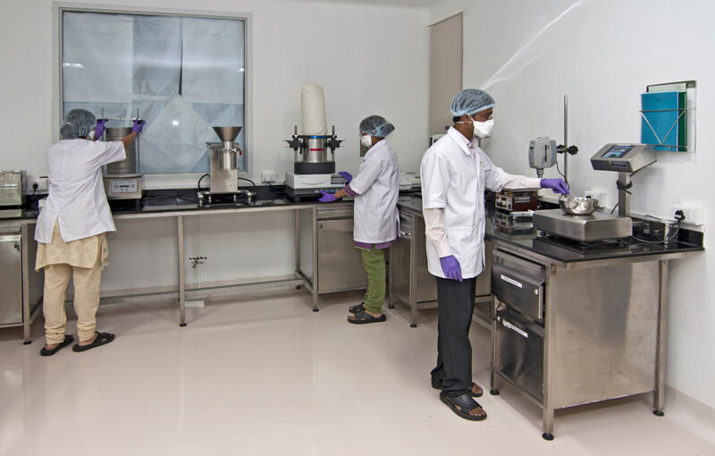 Lab technicians in a pharma company