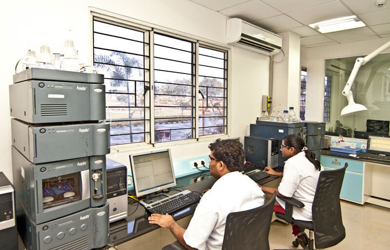 two lab technicians working inside a pharma plant in hyderabad