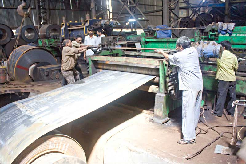 workers working on a steel sheet rolling company