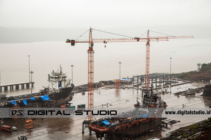 aerial view of a port with tower cranes