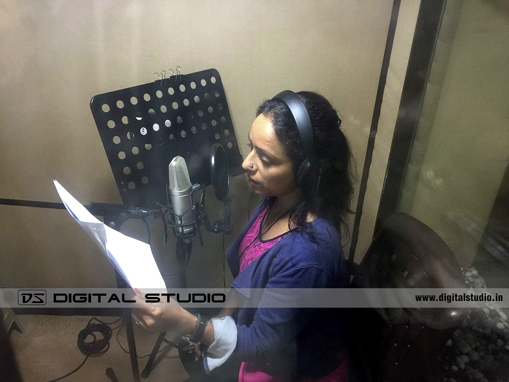 Female voice over artist recording a script
