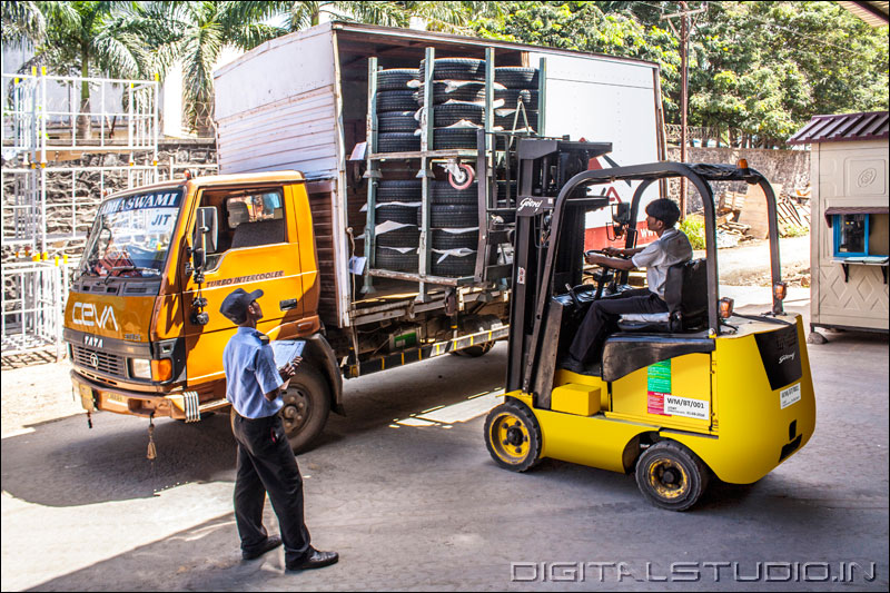 Forklift operator removing goods from a truck