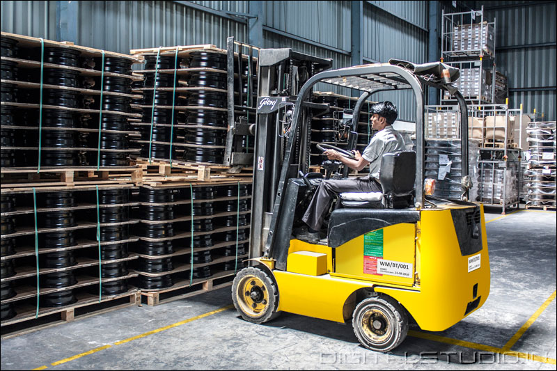 photograph of a worker with forklift in a  warehouse