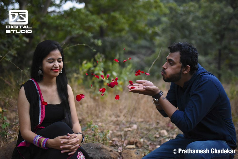 Boy blowing rose petals to the girl - pre Wedding shots