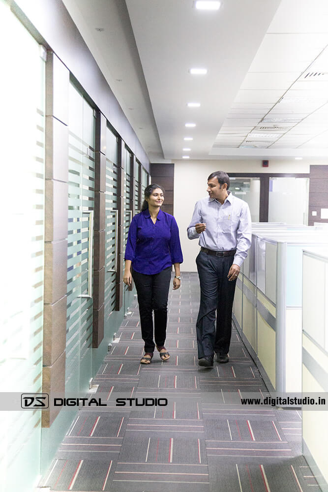 Two corporate executives walking in office corridor
