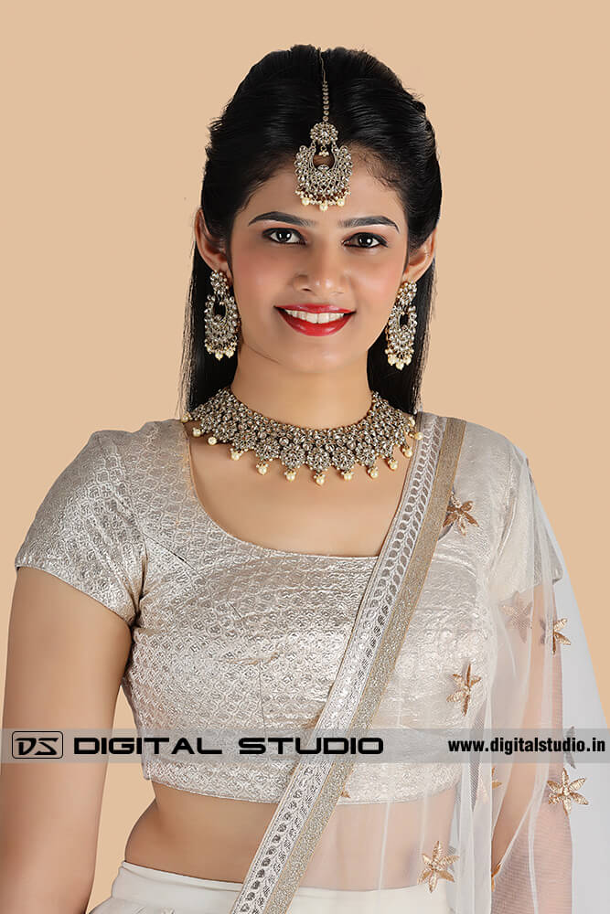 front photograph of model with heavy Indian jewellery