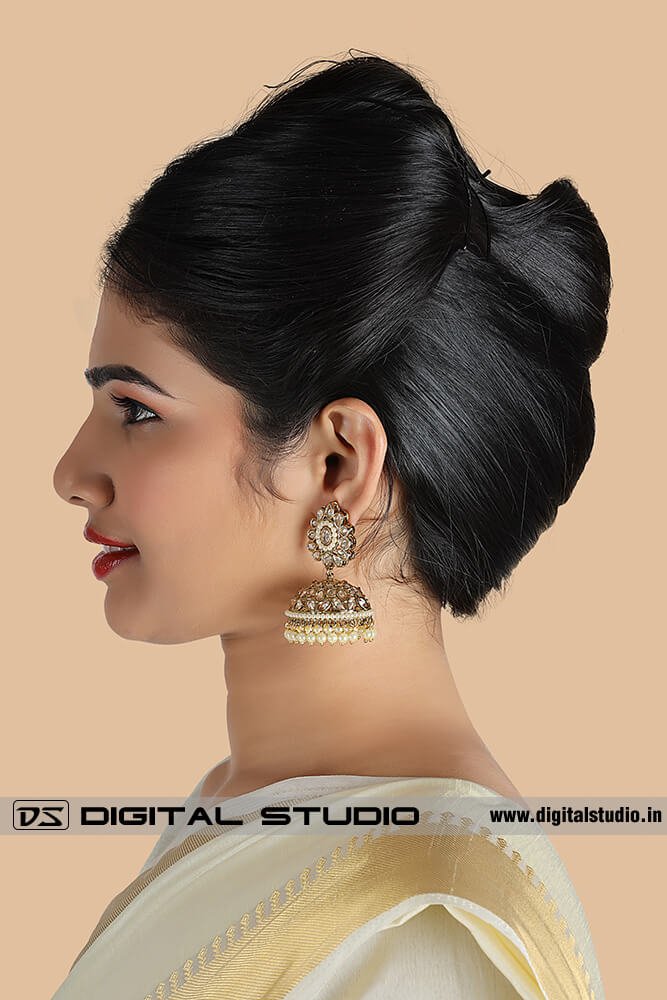 Profile photograph of model with jewellery