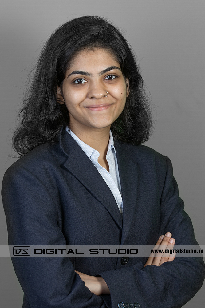 Smiling female executive wearing business suit