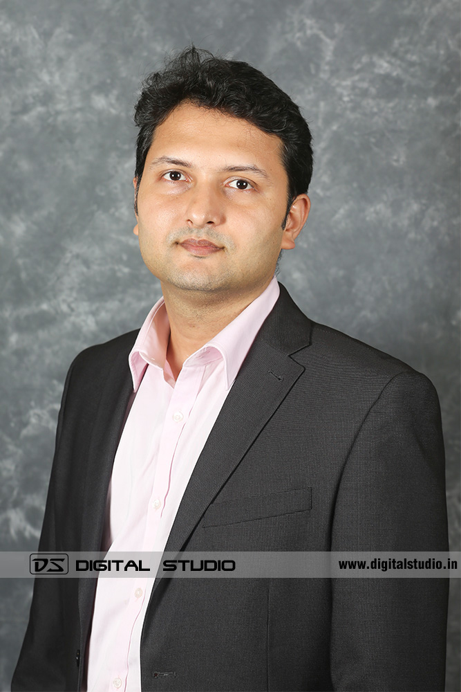 Managing Director posing on textured backdrop