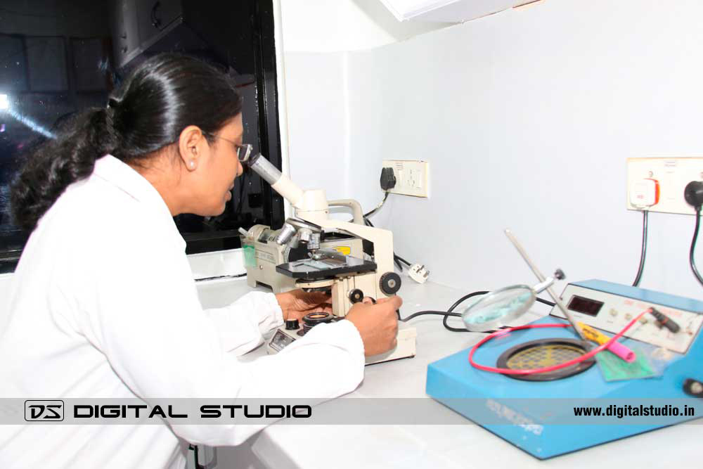Lady technician working on microscope