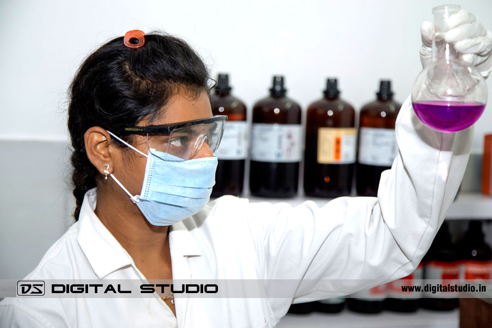 Woman lab technician working with solvents