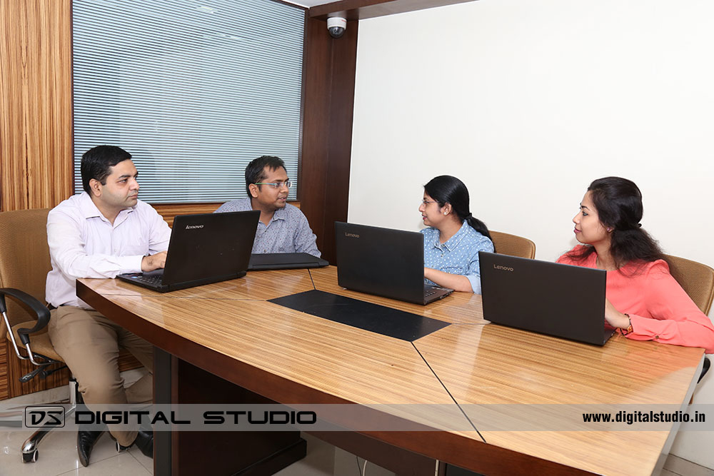 Corporate meeting between office staff with laptops