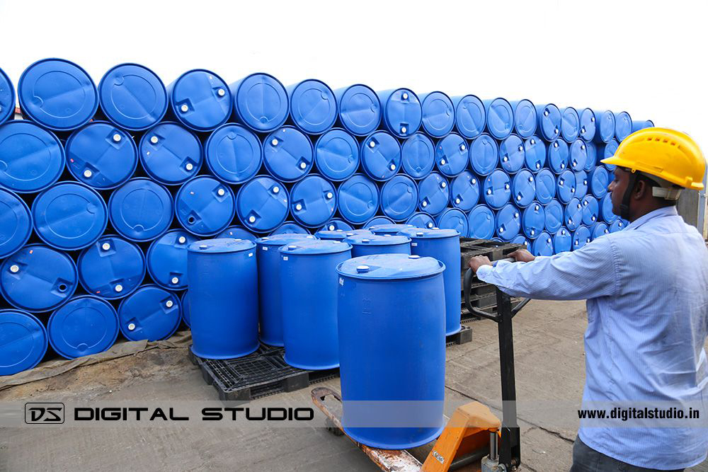 Worker keeping oil barrels and drums