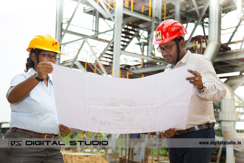 Two workers discussing a project in plant