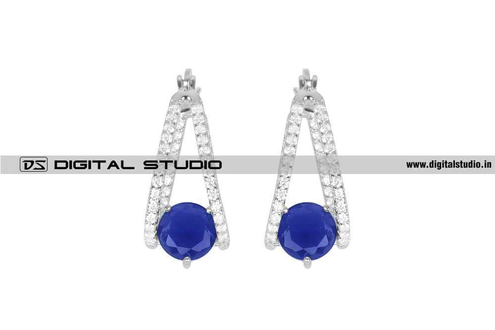 Dangling silver earrings with blue stone
