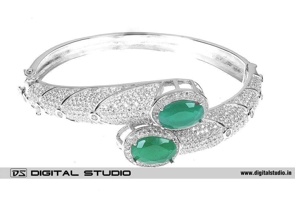 Pure silver bangle with green stones