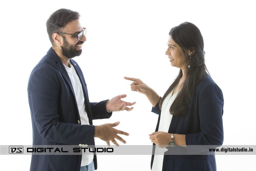 Couple gesturing on studio white background