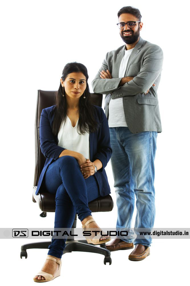 Couple on executive chair posing for photoshoot