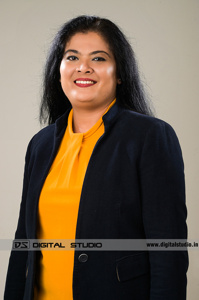 Female corporate headshot with light grey backdrop
