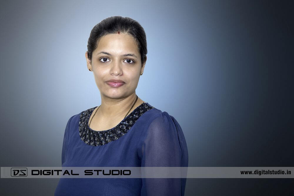 Lady exective in blue dress for Corporate Headshot photography
