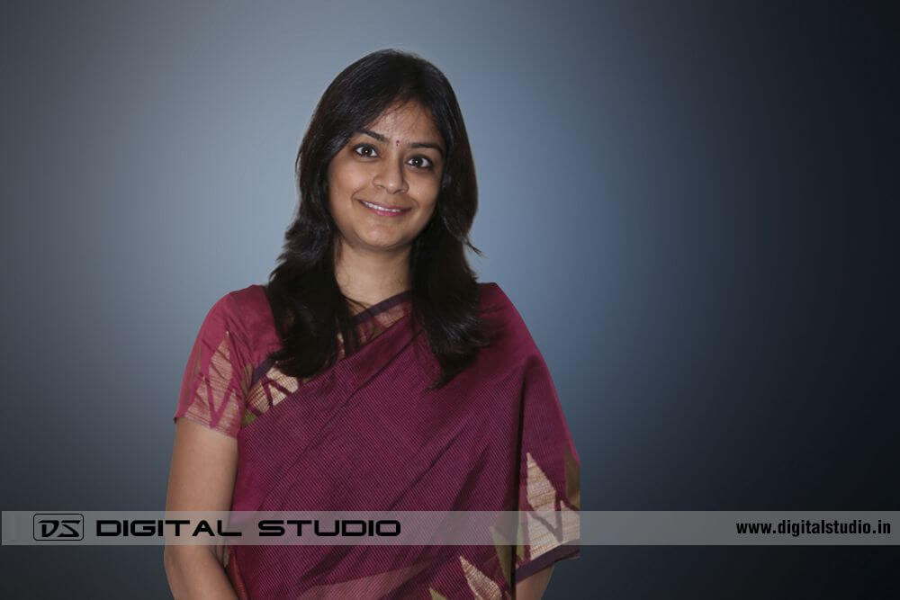 Lady executive in sari on creative background